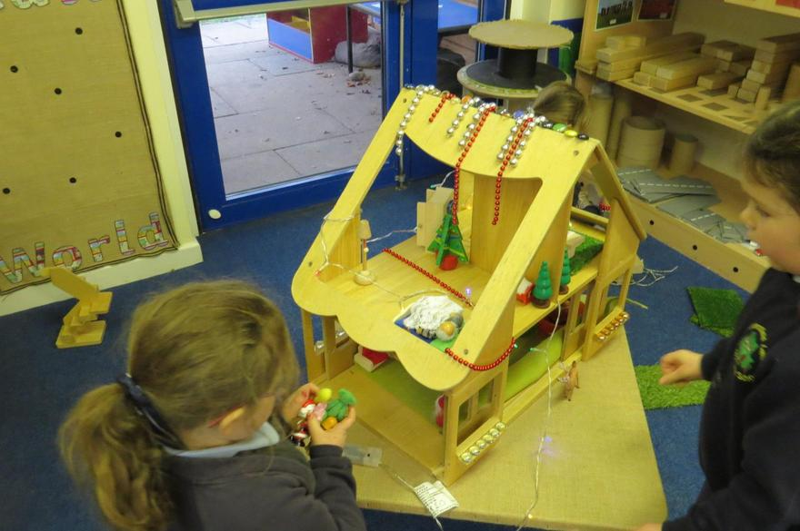 We decorated the dolls house for Christmas