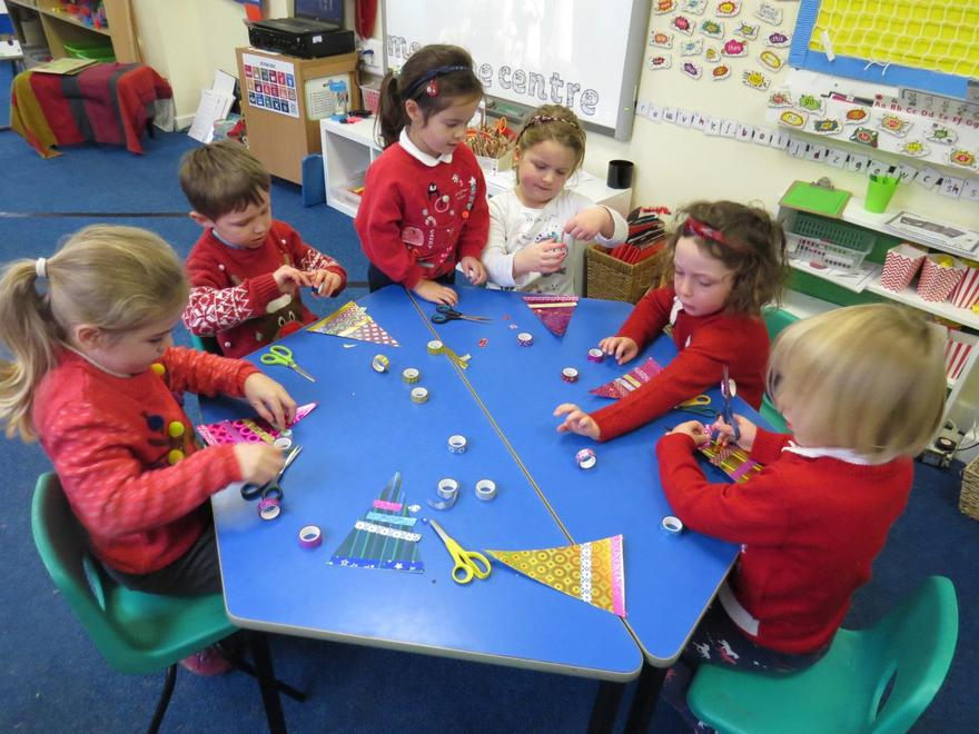 On Christmas jumper day we made decorations using holographic card and washi tapes..