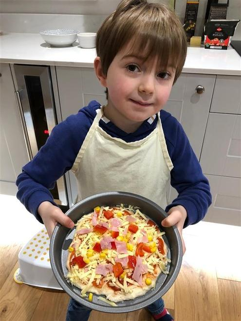adding toppings...