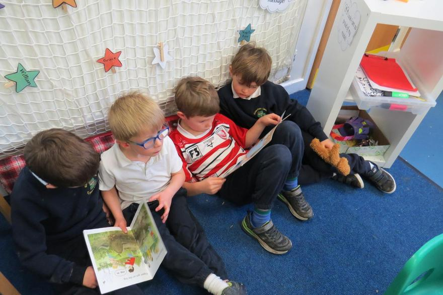 We read a bedtime story to baby bear.