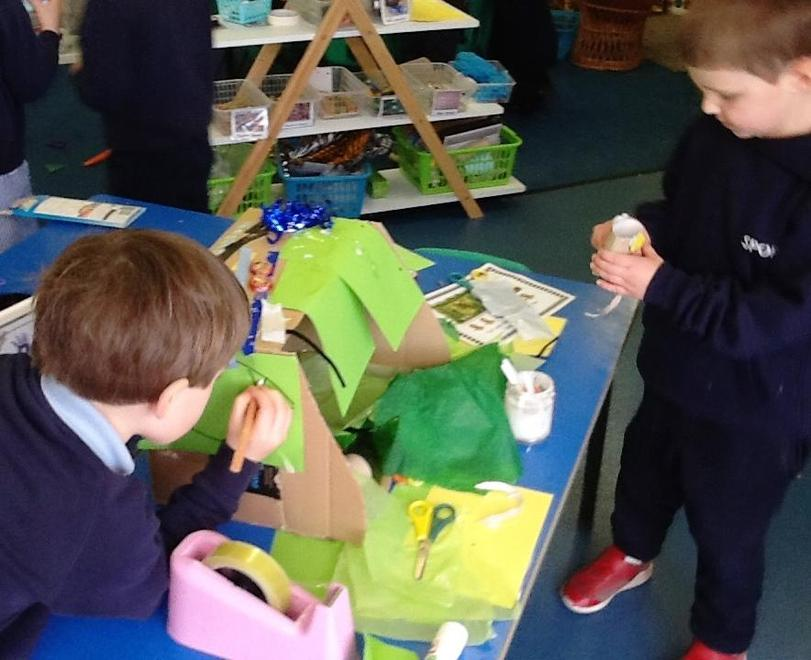 In the maker space creating a monkey cave.