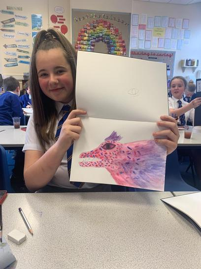 We used water colours to draw some wonderful dragons.