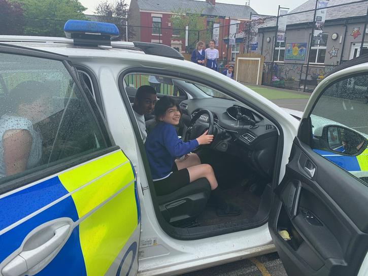 We enjoyed driving police cars!