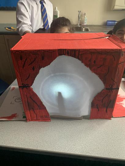 We learned all about LIGHT in Science. We made our own shadow puppet theatres.