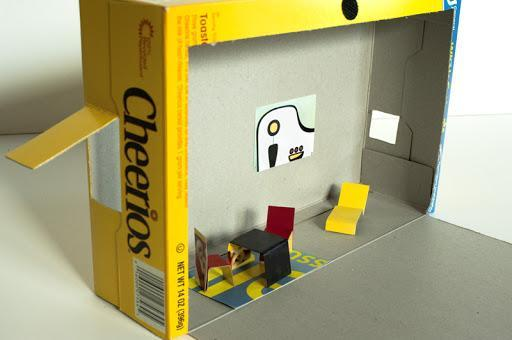 Make a cereal box house, with tiny cardboard furniture.