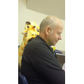 Who's that reading over Mr Pott's shoulder?