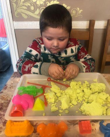 Leo using moulds and playdough