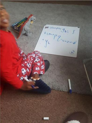 Ethan practising his alphabet