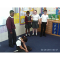 Children acting out Julius Caesar's early life.