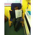 Felix reading our prayer book