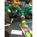 Developing our gross motor control as we caught fish