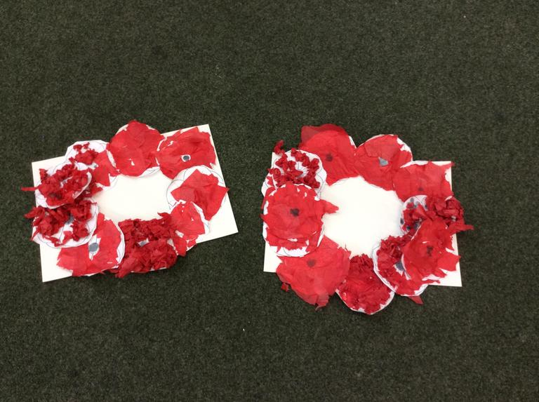 The children create poppies using different textures.