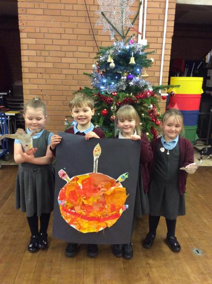 We took part in a virtual Christingle service with Father Chris.
