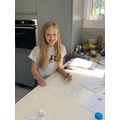 Lilly working on her spelling challenges
