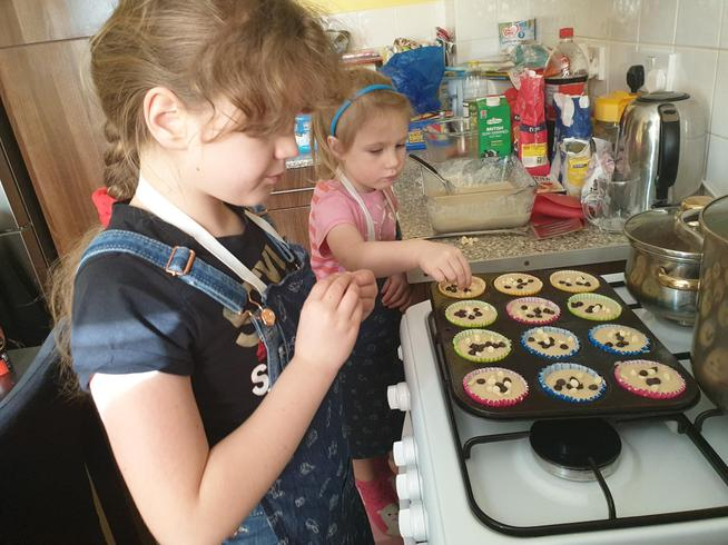 Emilia and her big sister have been baking cakes.