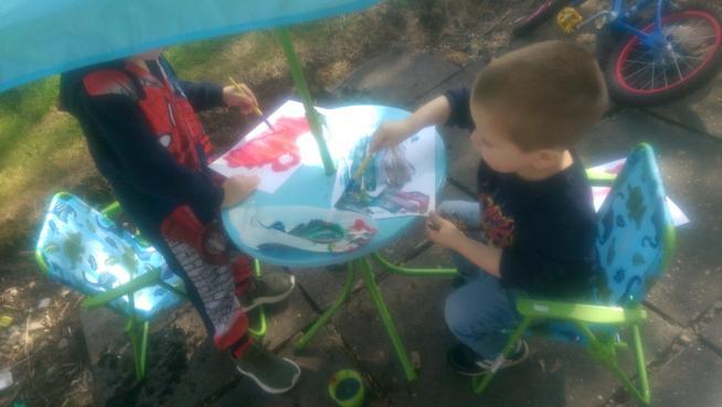Eli enjoying the sunshine and painting outdoors.