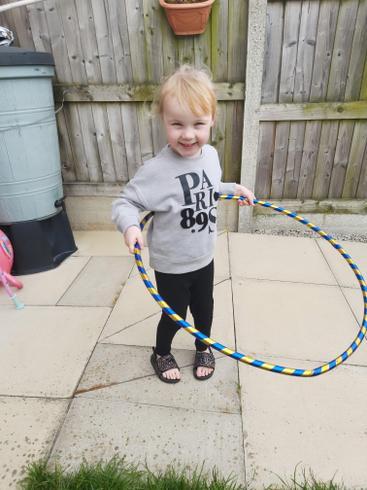 Sienna has been hula hooping in her garden.