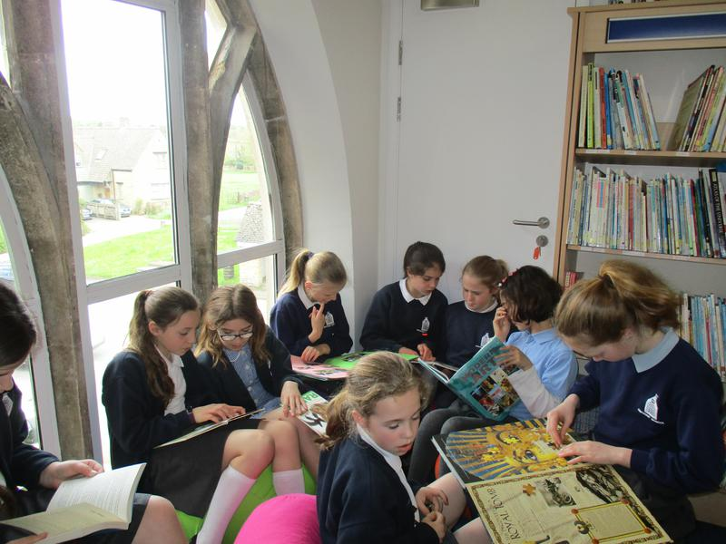 Year 5 and 6 enjoying a lunchtime library session