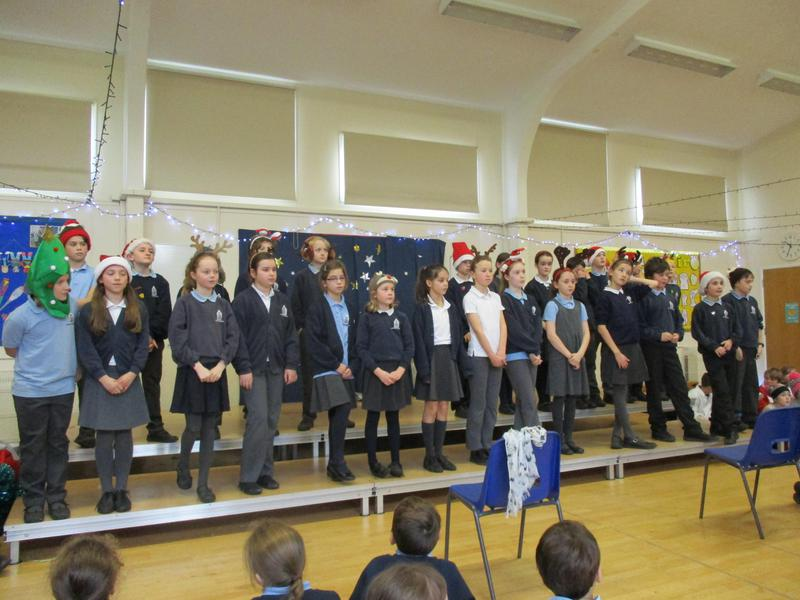 Years 5 and 6 performing for their peers