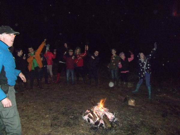Singing and dancing around the campfire