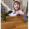 B loves playing with dinosaurs.
