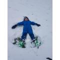 E loves doing snow angels