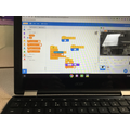 Creating an algorithm in Scratch.