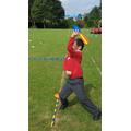 Adding totals after javelin throwing.