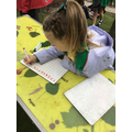We enjoyed writing numbers in the outdoor area.