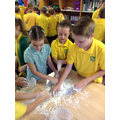 Kneading the dough - a very messy job!