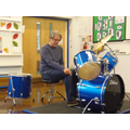 Mr McClure demonstrating the drums.