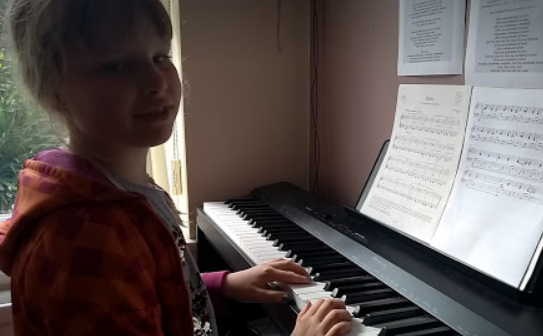 Fiona practising on the piano.