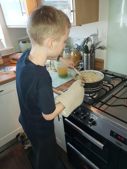 Archie making risotto.
