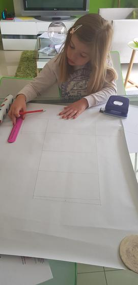Amelie working hard designing her pencil case!