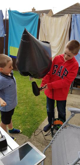 Ryan and his brother making a hot air balloon.