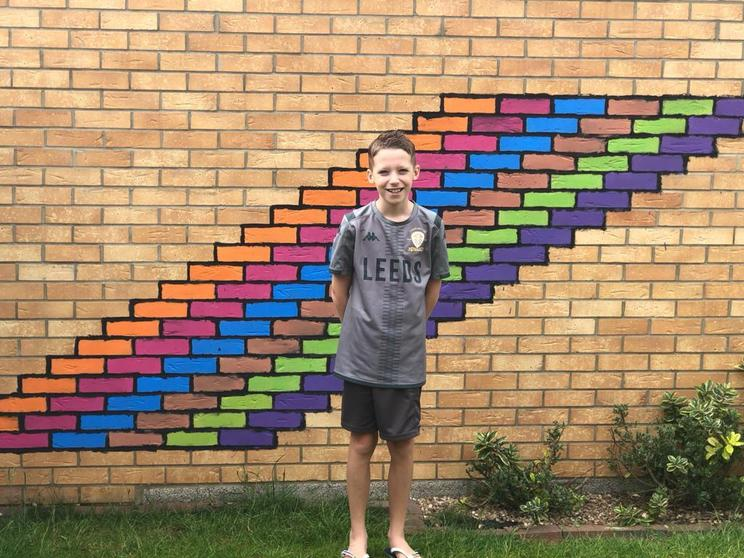 George painted his garage wall.