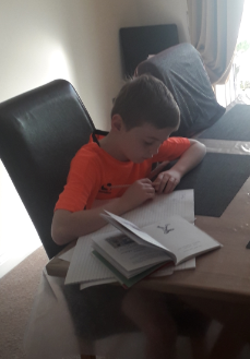 Isaac working hard on his Math's and RE work.