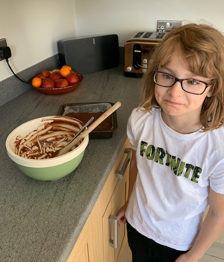 Evie baking some brownies.