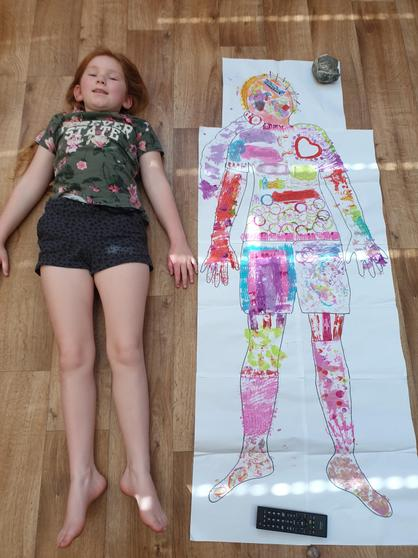 Lucy painted a life size version of herself!