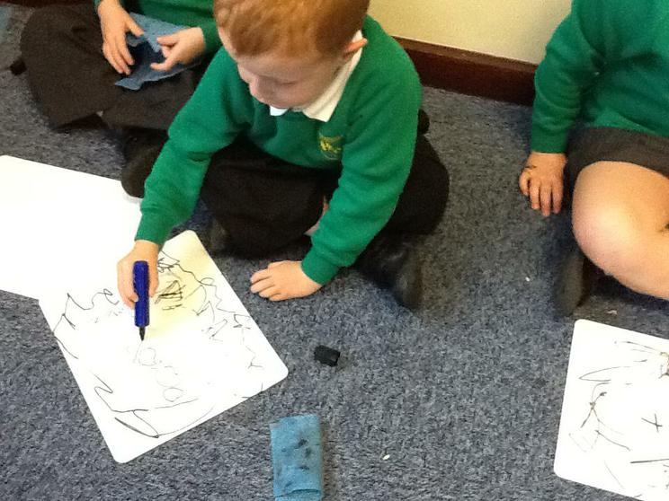 We practise our writing on whiteboards