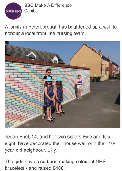 Evie & Isla's super rainbow wall made the news!