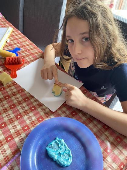 Louisa doing art printing.