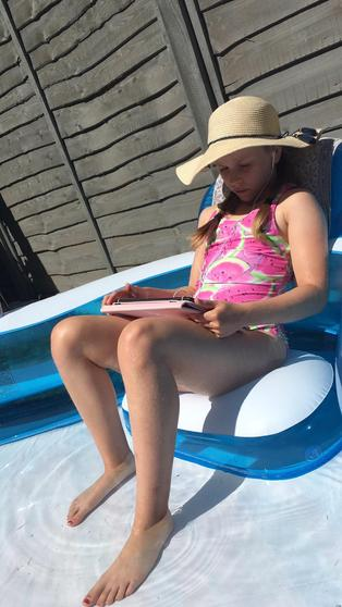 Isabella playing spelling shed in her pool.