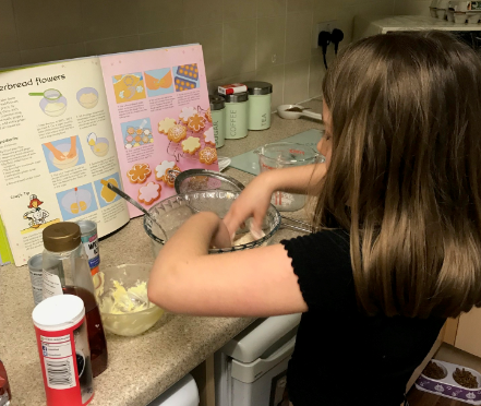 Gracie making gingerbread flowers.
