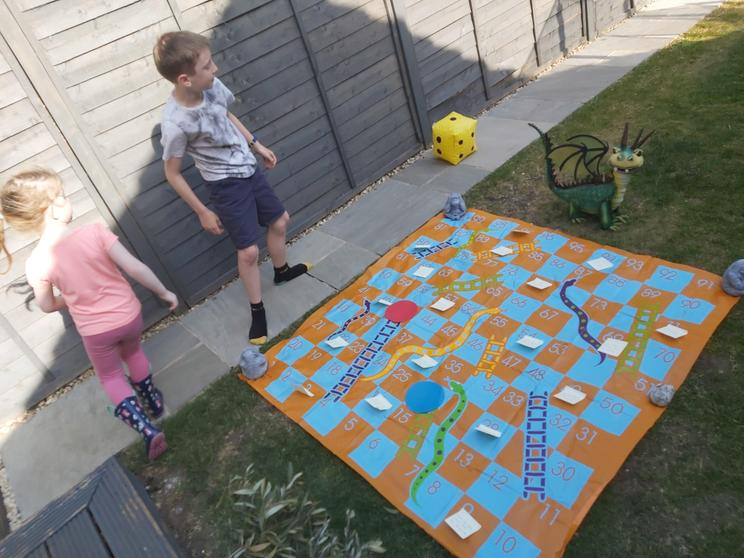 Archie playing PE snakes and ladders.