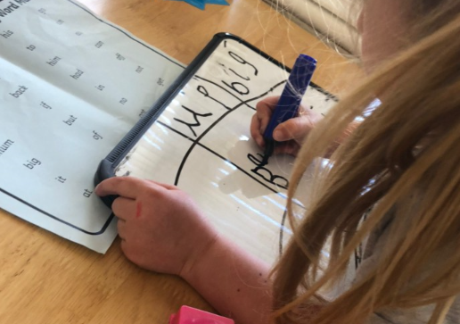 Phonics practise using a whiteboard