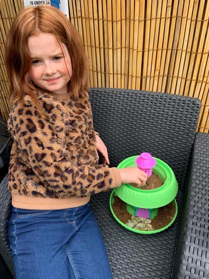 Evie planting a fairy garden
