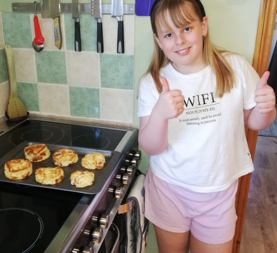 Charlotte making scones for afternoon tea.