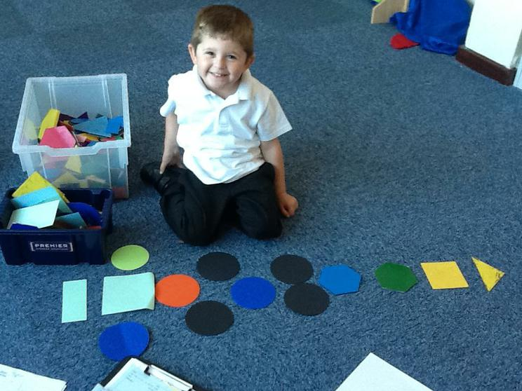 We create pictures using shapes & talk about them.