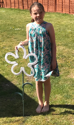 Gracie made a flower for her garden.